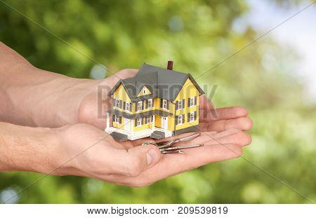 Holding model hands house closeup business human