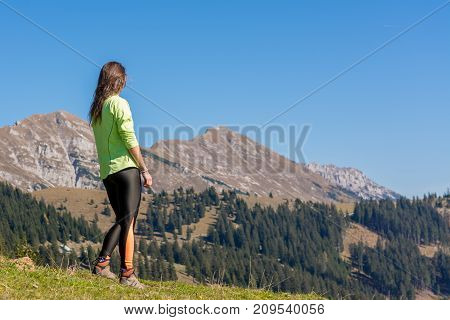 Female hiker planing her next hike. Personal trainer at work.
