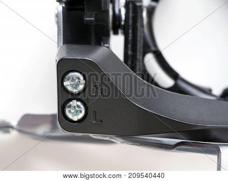 Bike front derailleur adjusting screws close up.