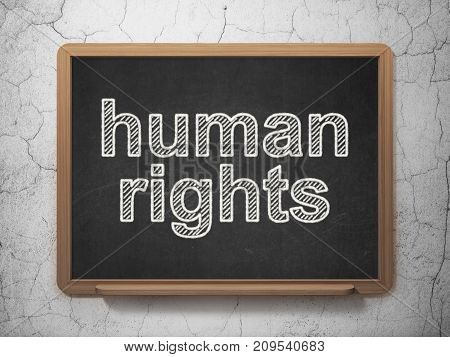 Politics concept: text Human Rights on Black chalkboard on grunge wall background, 3D rendering