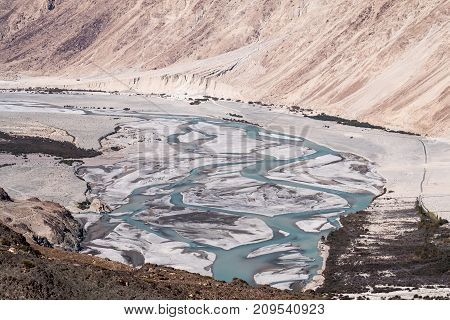 Landscape image of the blue Shyok river on the way to Nubra valley Ladakh India