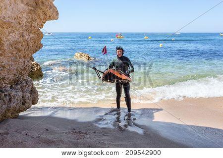 Underwater hunter preparing to dive. Underwater fishing in the Atlantic Ocean.