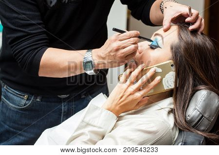 Woman talking on the phone at the beauty salon