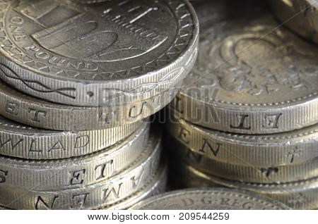 UK money, stack £1 coins close up