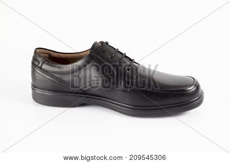 Male black leather shoe on white background, isolated product.