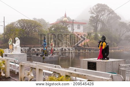 Hindu staues in a famous temple (Grand Basin) in the day with mist create mystical atmosphere.Mauritius