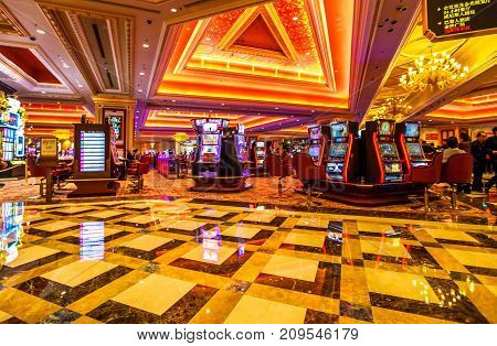 Macau, China - December 9, 2016: The Venetian Luxury Casino hall with game machines. The Venetian is the largest casino in the world and the largest single structure hotel building in Asia.