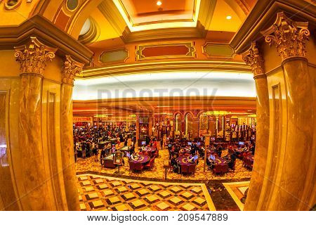 Macau, China - December 9, 2016: aerial view of black jack tables and gamblers inside of Venetian Casino and Hotel Resort. Macao is the capital of casinos and Asian gambling and, now, in the world.