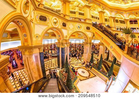 Macau, China - December 8, 2016: The Great Hall of Venetian Luxury Resort and aerial view of indoor Casino with black jack tables and gamblers in Macao. The Venetian is the twin Casino of Las Vegas.