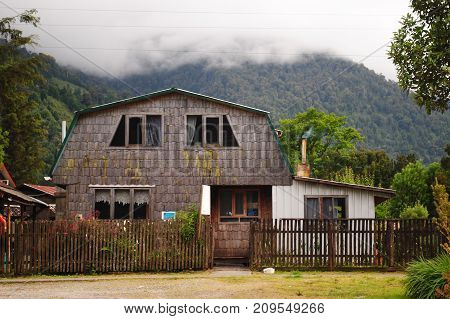 Old wooden house in a small fishing village / Aged cabin made of wood tiles