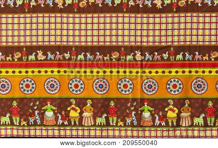 background: fragment of tablecloth in traditional Russian folk style with the images of Dymkovo toys also known as the Vyatka toys or Kirov toys