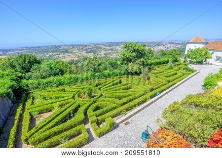 Sintra, Portugal - August 9, 2017: Beautiful gardens in Seteais Palace, a neoclassical palace in historic center of Sintra and Unesco Heritage. Palacio de Seteais has become the five star Tivoli Hotel