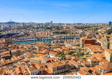 Picturesque Oporto urban landscape on Douro River and city skyline from Clerigos Tower, the highest point in the city of Porto. Beautiful cityscape in a sunny day