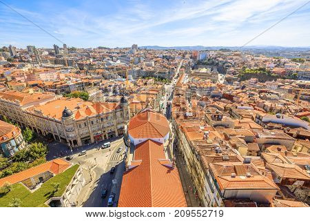 Aerial view of historic city center of Porto in Portugal from Clerigos Tower, one of the landmarks and symbols of Oporto. Urban skyline landscape.