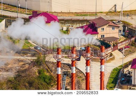 Aerial view of cottages and smoking chimneys in sunny day Sochhi Russia