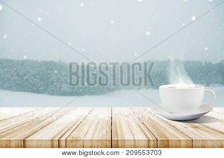 Cup Of Coffee On Wooden Table With Winter Snowfall Covered Forest. Christmas And New Year Background