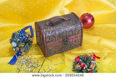 Christmas background with decorations bells ribbon and balls and chest