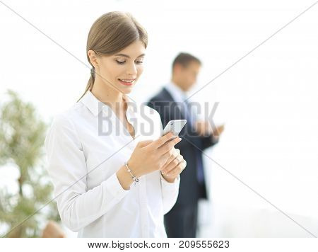 Closeup portrait young, shocked business woman, looking at cell phone