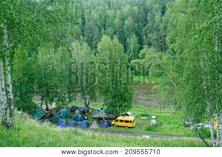 Beklenischevo, Russia - June 12, 2005: Group camps near Iset river. Sverdlovsk region