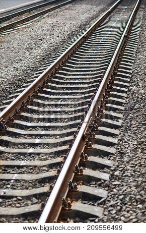 Railroad close-up on a gray shingle at a train station standard