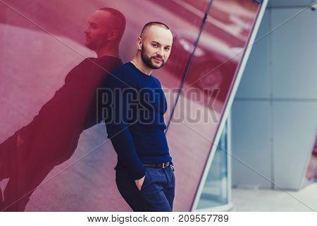 Portrait handsome stylish man in elegant clothes. Outdoor fashion portrait.