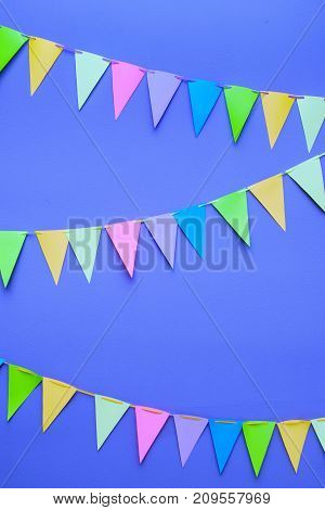 Colorful Triangle Diy Party Flags On A Rope On Background Of A Dark Gray Wall