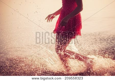 young girl runs on water at sunrise