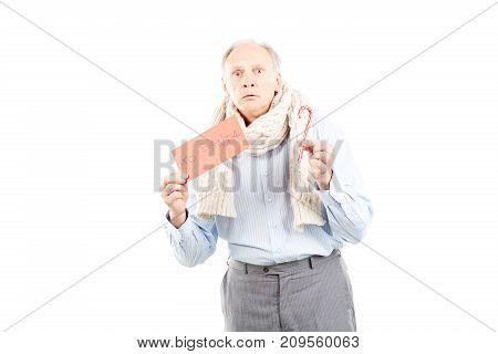 Portrait of senior man holding envelope with letter to Santa