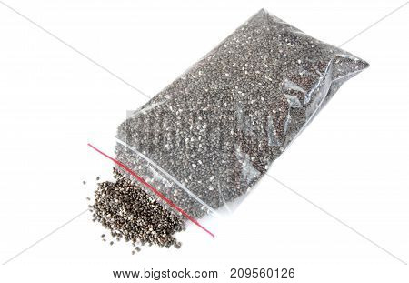 chia seeds in cellophane bag on white background
