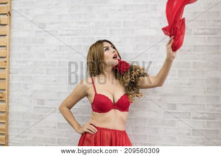 Woman In Sexy Red Swimsuit Poses In Bedroom.