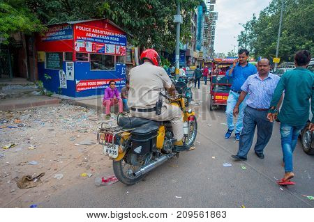 DELHI, INDIA - SEPTEMBER 25 2017: Unidentified people riding there motorbikes in the streets of Paharganj, Delhi in India.