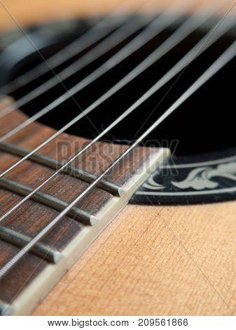 Closeup image of standard six string guitar. Selective focus