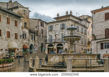 Fountain on Piazza del Comune in Assisi city center Italy