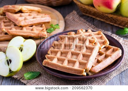 Healthy apple waffles on a wooden table