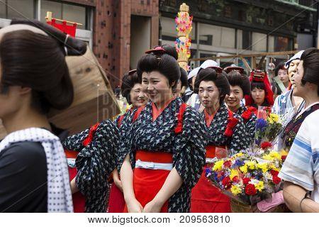 Tokyo, Japan - September 24 2017: Women Dressed In Red And Black Edo Customes At Shinagawa Shukuba M