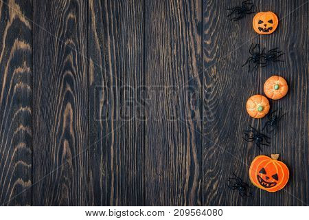 Halloween holiday background with cookies and spiders. View from above.