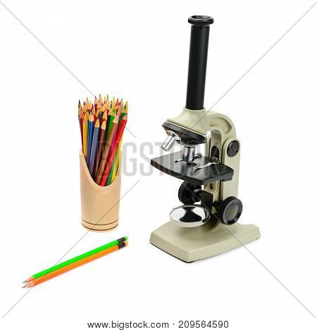 laboratory microscope and set of pencils isolated on white background