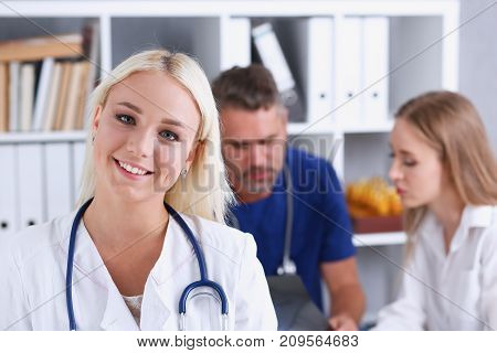 Beautiful smiling female doctor stand in office portrait. Physical and patient disease prevention exam er ward round 911 prescribe remedy healthy lifestyle consultant nurse profession concept