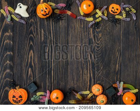 Halloween holiday background with candy and cookies. View from above.