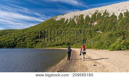 Walking along side a lake / Hiking in Patagonia near a lagoon