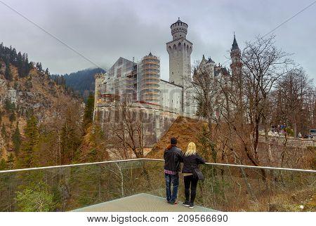 The famous German castle Neuschwanstein under dramatic sky. Germany. Bavaria.