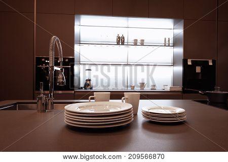modern high-tech kitchen interior in dark brown tones with a high shiny mixer