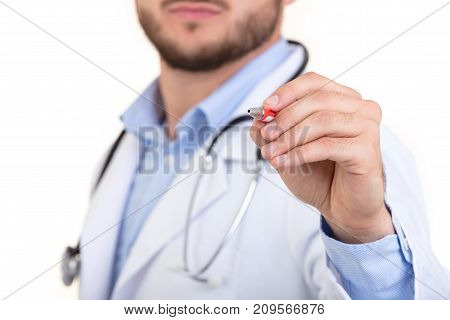 Doctor hand with a pen pointing on white.