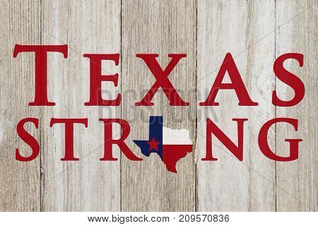 A rustic old Texas Strong message Texas flag on weathered wood background with text Text Strong