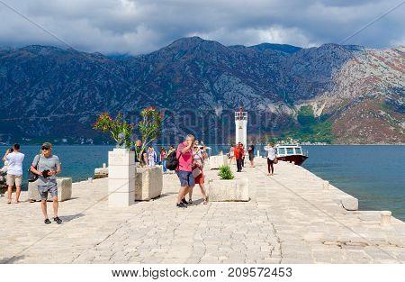 PERAST MONTENEGRO - SEPTEMBER 10 2017: Unknown tourists visit Gospa od Skrpela Island in Bay of Kotor Montenegro