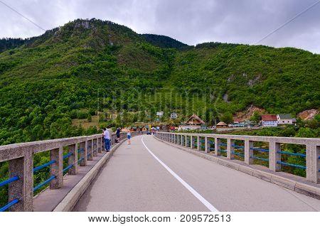 CANYON OF TARA RIVER MONTENEGRO - SEPTEMBER 12 2017: Unknown tourists are on Djurdjevic Bridge over canyon of Tara River Montenegro