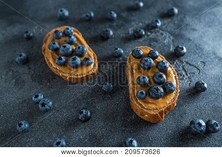 Snack with bread, peanut butter and berries. Healthy food concept.