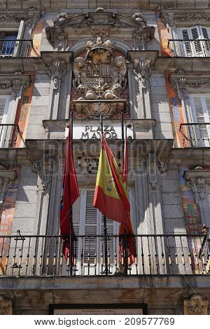 MADRID, SPAIN - MAY 24, 2017: This is an architectural fragment with the Spanish coat of arms on the building on the Plaza Mayor.
