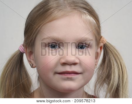 Portrait of a little girl with blond hair