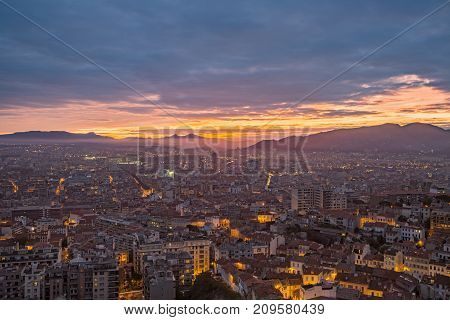 Beautiful colorful sunrise over Marseille with mountains in the foreground